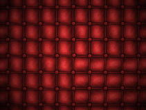 Texture leather quilted a sofa. Red color Royalty Free Stock Images