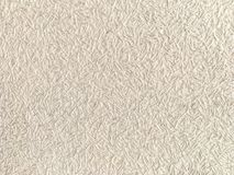Texture of light beige wallpaper with a pattern Royalty Free Stock Images