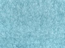 Texture of light blue wallpaper with a pattern. Sky paper surface, structure close-up Stock Photography