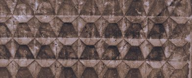 Texture of light brown old concrete fence with scuffs and cracks. Wallpaper for design royalty free stock images