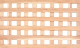 Texture light brown wood fence with blank space alternating patterns in vertical and horizontal square shaped isolated on white. Close up Texture light brown stock images