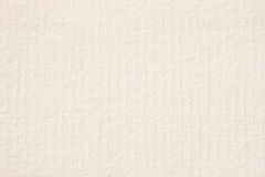 Texture of light cream paper for watercolor and artwork. Modern background, backdrop, substrate, composition use with stock images
