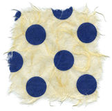 Isolated Rice Paper Texture - Blue Polka Dots XXXXL. Texture of light cream yellow rice paper with blue polka dots embedded, with torn edges. Isolated on white Stock Images