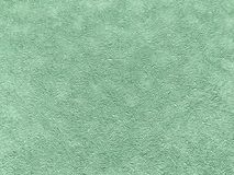 Texture of green wallpaper with a pattern. Texture of light green wallpaper with a curly pattern. Cyan paper surface, structure close-up Stock Photos