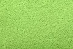 Texture of light green wool textile material closeup. Green abstract background. High resolution photo. Full depth of field stock image