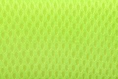 Texture of light green wool textile material closeup. Green abstract background. High resolution photo. Full depth of field stock photo