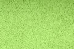 Texture of light green wool textile material closeup. Green abstract background. High resolution photo. Full depth of field royalty free stock photos