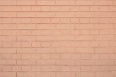 Texture of light orange brick wall. Blank space. Coral stone background. Brick pattern on coral backdrop. Yellow concrete texture. Texture of light orange brick royalty free stock photo