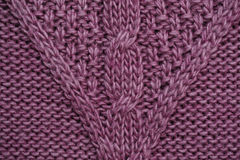 Texture of lilac knitted fabric for the background Stock Photos