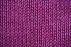 Texture of lilac knitted fabric for the background Royalty Free Stock Photo