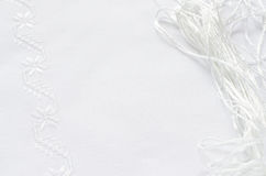 Texture of linen fabric with white silk embroidery Stock Photo