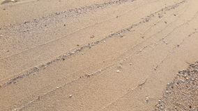 Texture lines of sand on the beach Royalty Free Stock Photos