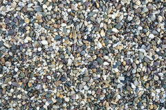 Texture of little rounded colorful stones Royalty Free Stock Images