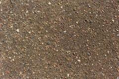 Texture lourde grise et brune de revêtement de route goudronnée Photo libre de droits