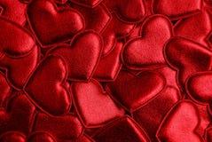 Texture lumineuse rouge de petits coeurs décoratifs Image libre de droits