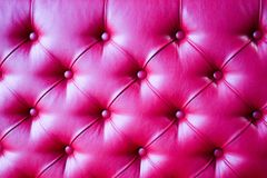 Texture of a luxurious, bright, beautiful, pink, stitched leather sofa with rivets, buttons, backdrop stock photos