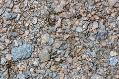 Texture macadam stones gray. Abstract natural building background with gray small stones in the form of rubble Stock Photography