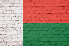 Texture of Madagascar  flag. On a pink brick wall Royalty Free Stock Photo