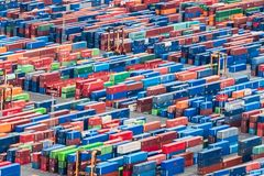 Aerial view over shipping containers stacked on a commercial port. Texture made with an aerial view over shipping cargo containers stacked on a commercial port stock image