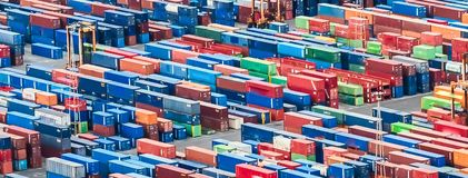 Aerial view over shipping containers stacked on a commercial port. Texture made with an aerial view over shipping cargo containers stacked on a commercial port stock photo