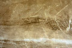 The texture of the marble is a green-brown shade. stock photo