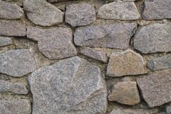Texture of a masonry fragment of an ancient wall. Stock Images