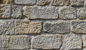 Texture of a massive stone wall Royalty Free Stock Images