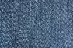 Texture of a material from denim. Of blue color Stock Image