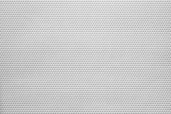 Texture of material perforated sheets white color Stock Photography