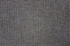 Texture of mats. Rough fabric with large weaving. Natural brown shades Royalty Free Stock Image