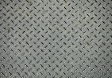 Texture. Metal dark list with rhombus shapes Stock Photography