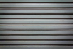 Texture of metal door. Background Detail of texture metal door Corrugated Iron Panelling Stock Image