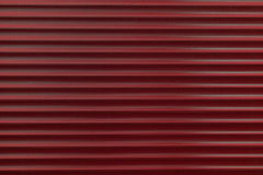 The texture of a metal roller of different colors. The background of the iron blinds. Protective roller shutters for entrance door stock photography