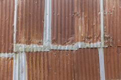 Texture of metal rusted corrugated sheets. Backdrop Stock Photography