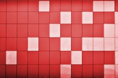 The texture of the metal wall, framed in the form of colored squares of two colors. Modern wall design for the exterior of reside Royalty Free Stock Photo