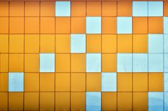 The texture of the metal wall, framed in the form of colored squares of two colors. Modern wall design for the exterior of reside Royalty Free Stock Image