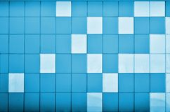 The texture of the metal wall, framed in the form of colored squares of two colors. Modern wall design for the exterior of reside Stock Image