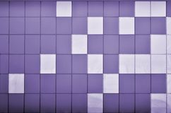 The texture of the metal wall, framed in the form of colored squares of two colors. Modern wall design for the exterior of reside Royalty Free Stock Photography