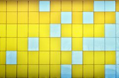 The texture of the metal wall, framed in the form of colored squares of two colors. Modern wall design for the exterior of reside Stock Images
