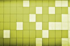 The texture of the metal wall, framed in the form of colored squares of two colors. Modern wall design for the exterior of reside Royalty Free Stock Images