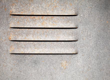 Texture of metal wall with ventilation grille Stock Photos