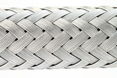 Texture of a metal wire braided reinforced hose. Macro image of a metal wire braided reinforced hose Stock Photos