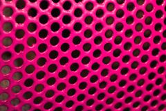 Texture metallic painted with pink glossy paint with black holes-glamorous triphofobia. Royalty Free Stock Photography