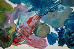Texture mixed oil paints in different colors stock photos