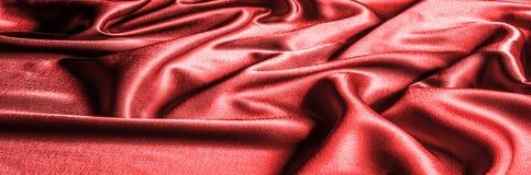 Texture, modèle tissu en soie rouge, fil métallique métallique elle Images stock