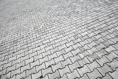Texture of modern gray cobblestone road pavement Royalty Free Stock Image