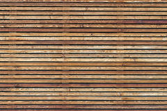 Texture of a modern wooden wall made of slats Royalty Free Stock Photography