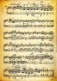 Texture modifiée de feuille et de papier de musique de cru Photos stock