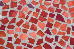 The texture of mosaic wall decorative ornament from ceramic broken tile in orange color, like Gaudi Stock Photos