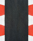 Texture of motor race asphalt and curb Grand Prix circuit. Texture of motor race asphalt and red white curb on Grand Prix street circuit royalty free stock image